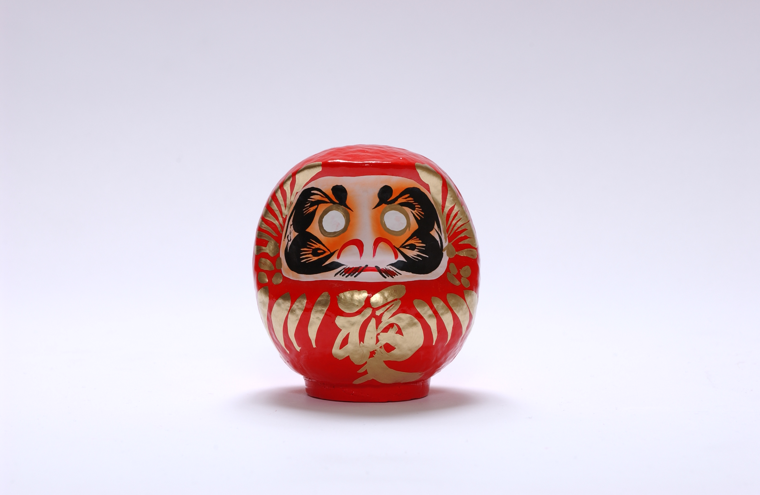 what does the japanese symbol mean on daruma dolls? | Yahoo